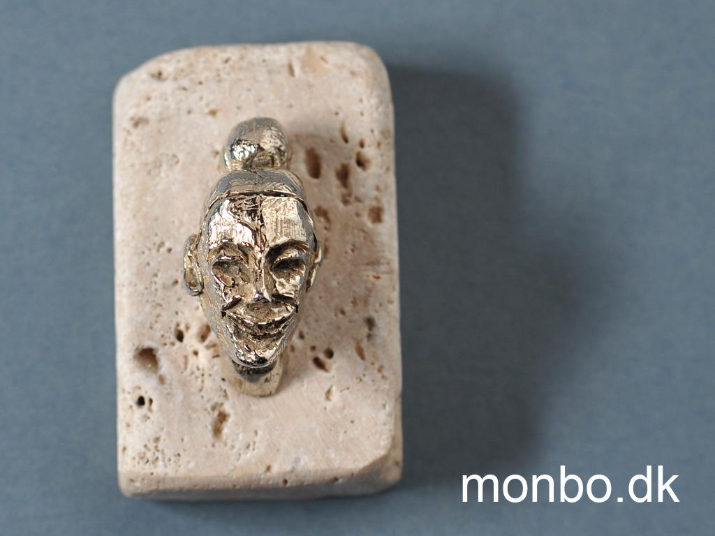 Kvindeansigt i sterling sølv